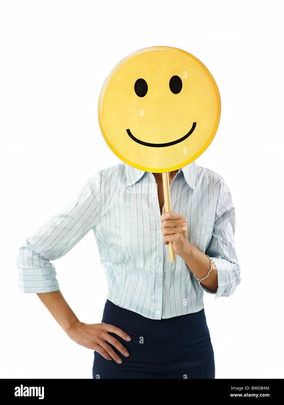 adult business woman holding smiley emoticon on white background. Vertical shape, front view, waist up Stock Photo