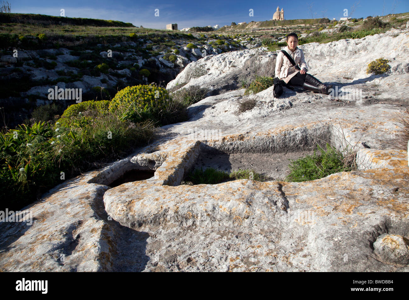 So-called rock cutouts called 'cart ruts' and dating to prehistory are found in several places on rocky - Stock Image