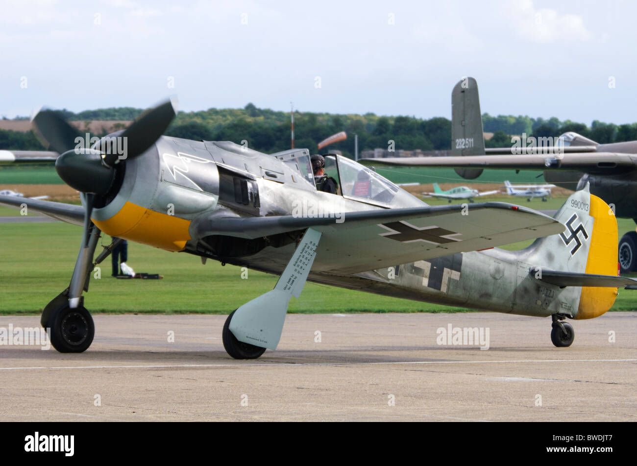 Flugwerk-built Focke Wulf FW 190 A8/N in Luftwaffe colours taxiing at Duxford Flying Legends Airshow - Stock Image