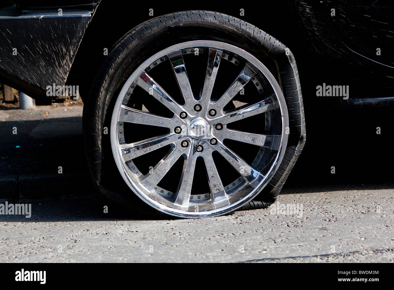 Flat Tyre on Hummer - Stock Image