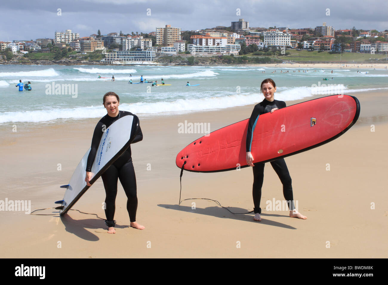 Mother and daughter surfers on Bondi Beach, Sydney, New South Wales, NSW, east Australia, Australasia - Stock Image