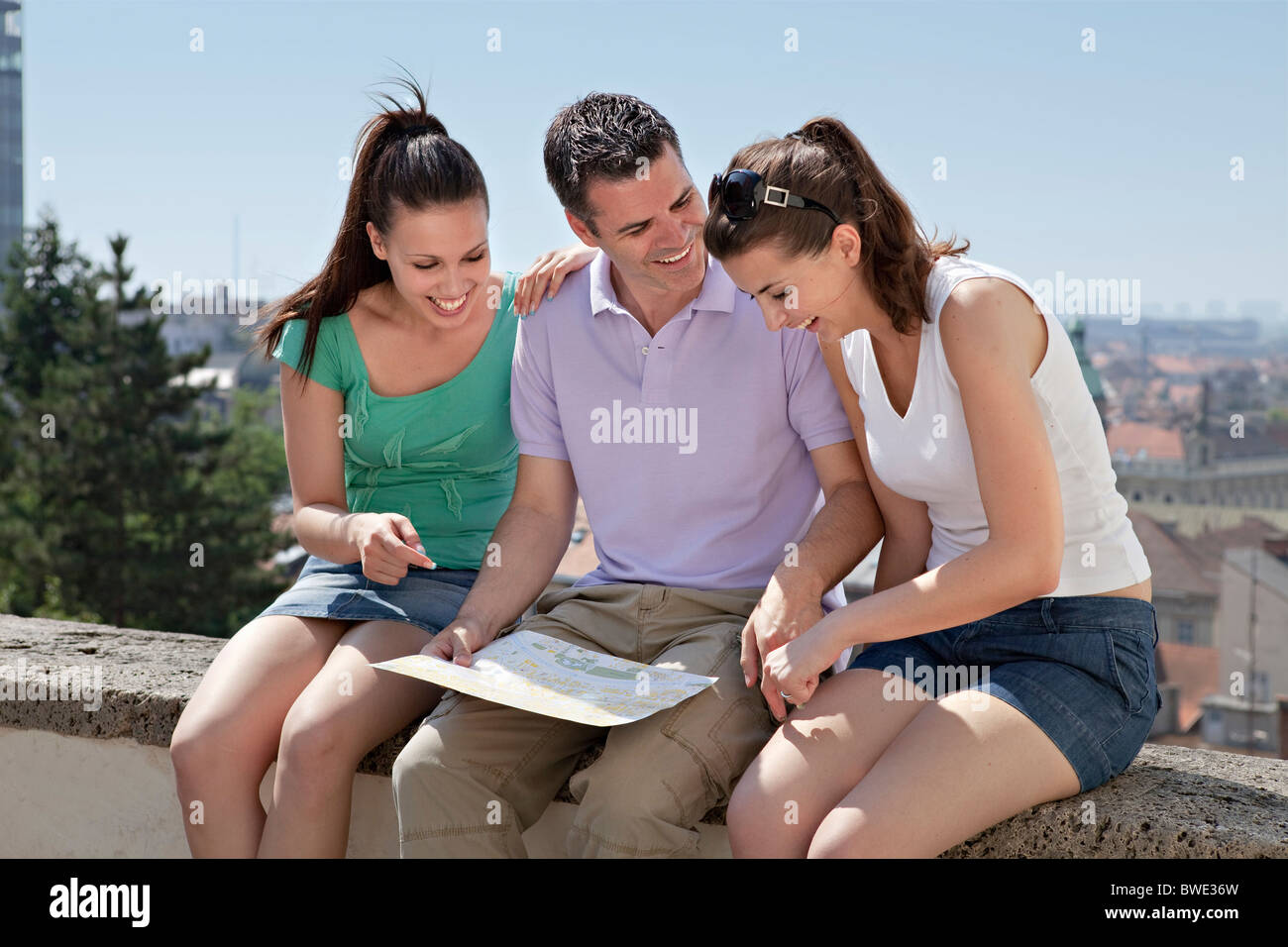 Young people looking at map Stock Photo