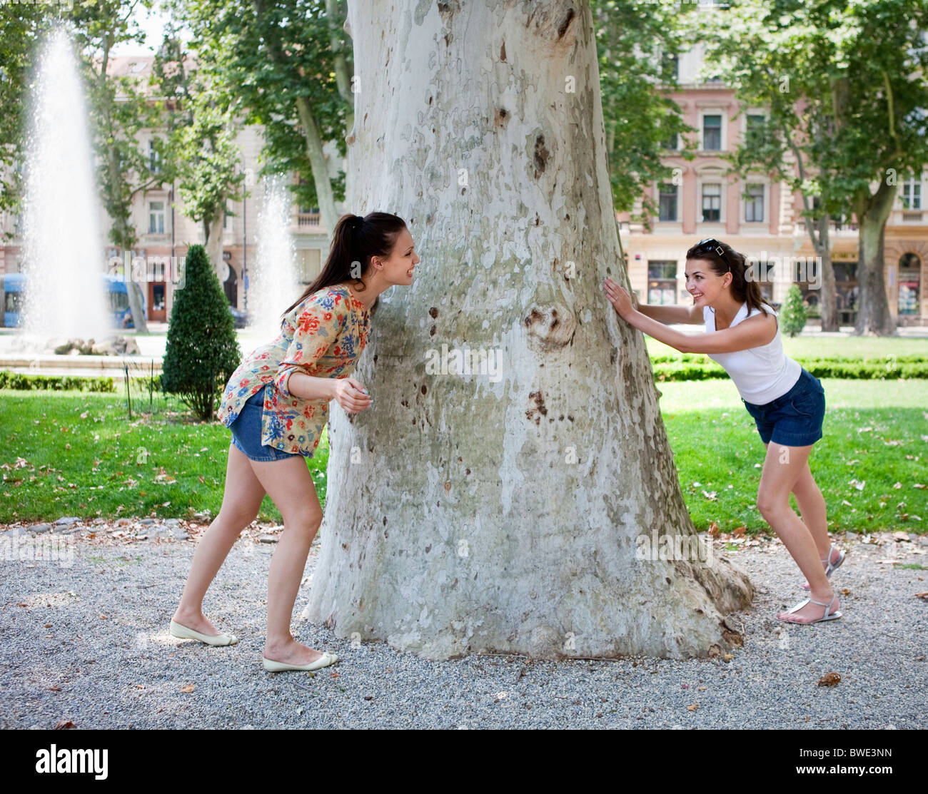 Young women playing hide and seek - Stock Image
