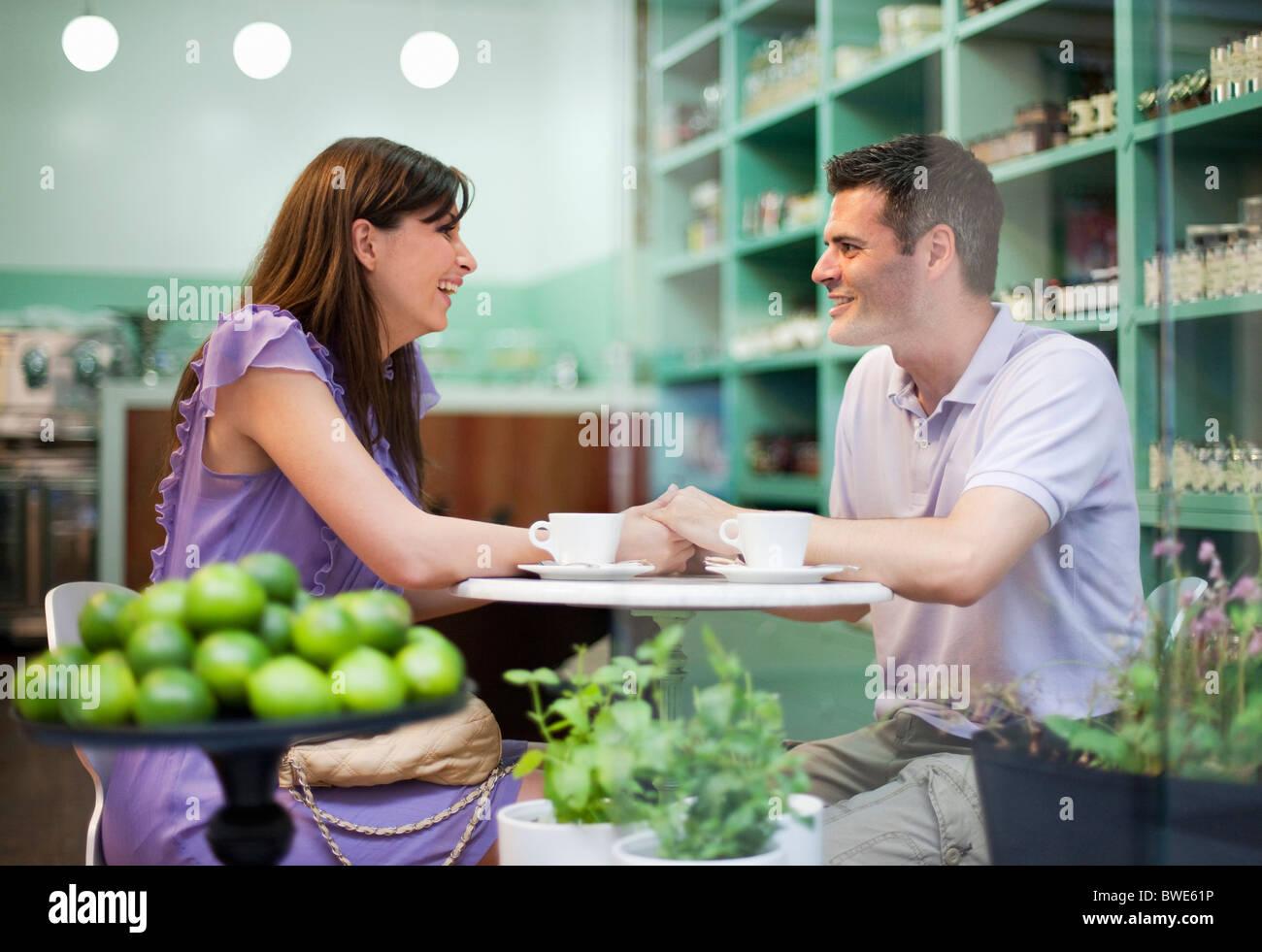 Couple in cafÈ store Stock Photo