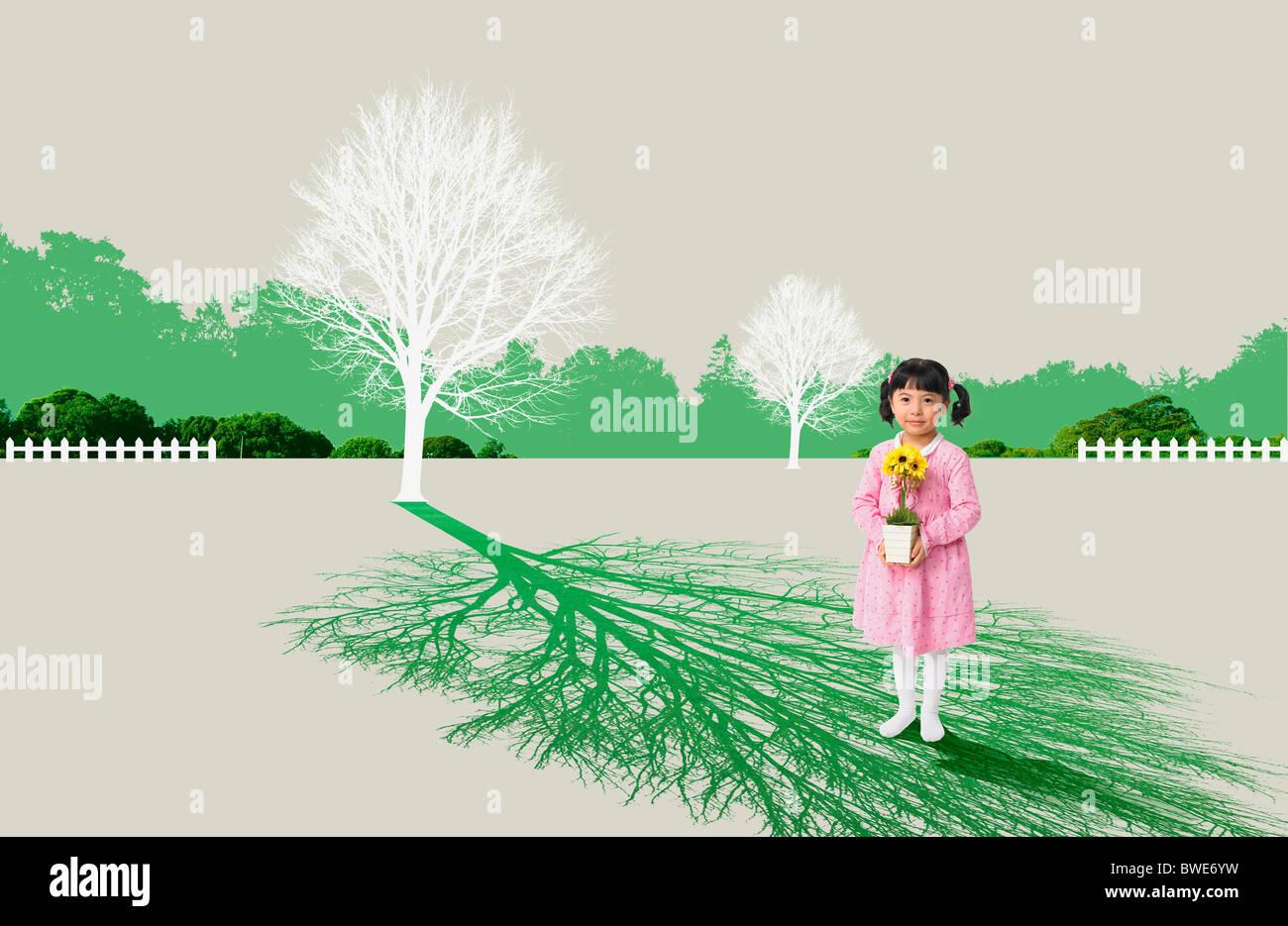 girl holds a flowerpot - Stock Image