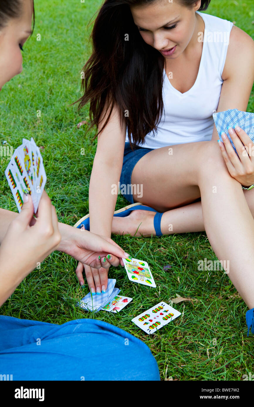 Young women playing card game - Stock Image