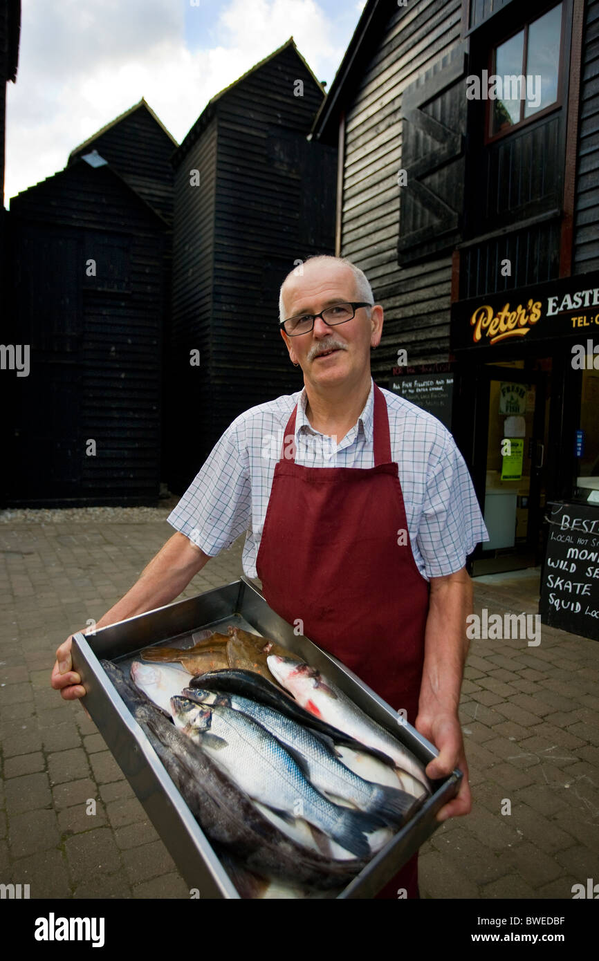 Peter was a fisherman for 30 years now has his own fresh fish shop at Hastings-Old-Town in one of the historic net - Stock Image