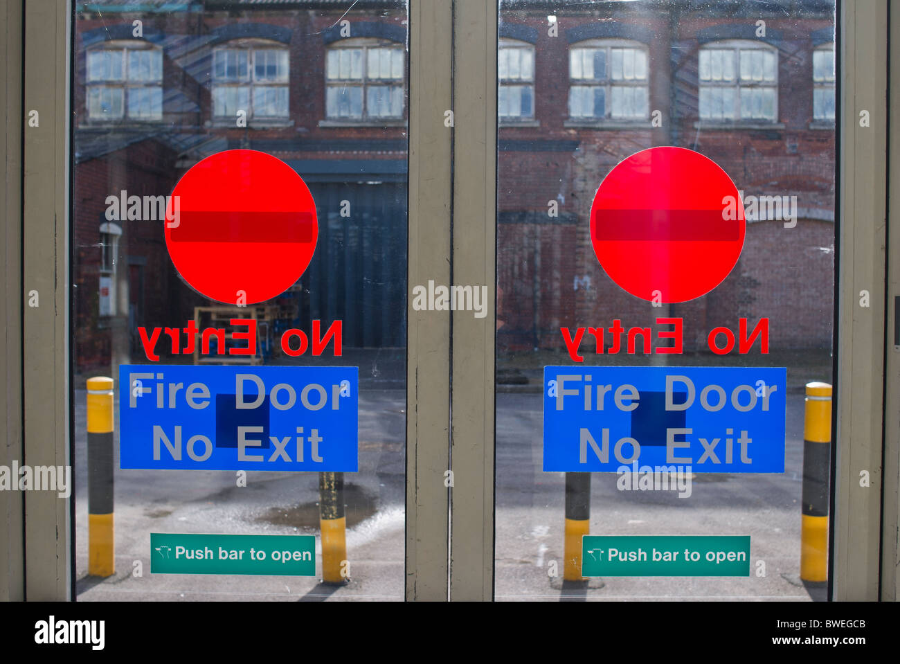 "Fire door ""No Exit"" signs in public shopping outlet centre in UK Stock Photo"