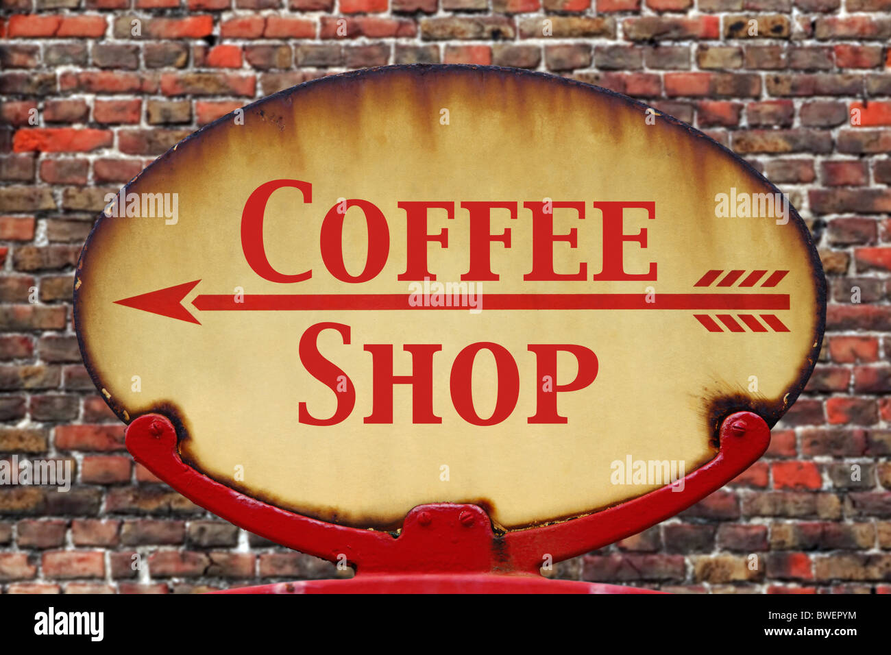 A rusty old retro arrow sign with the text Coffee shop - Stock Image