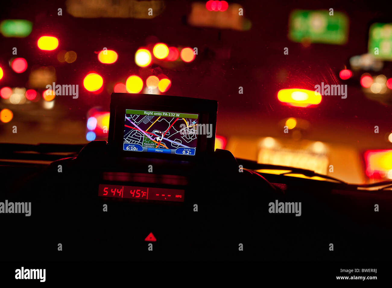 GPS unit in the window of a car in traffic. - Stock Image
