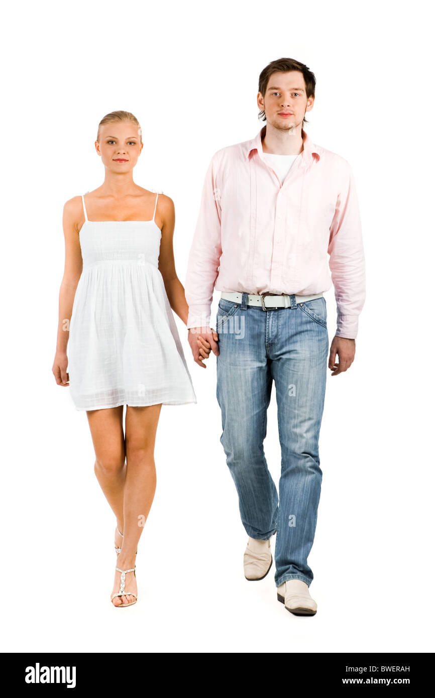 Handsome guy taking a walk with lovely girlfriend over white background - Stock Image