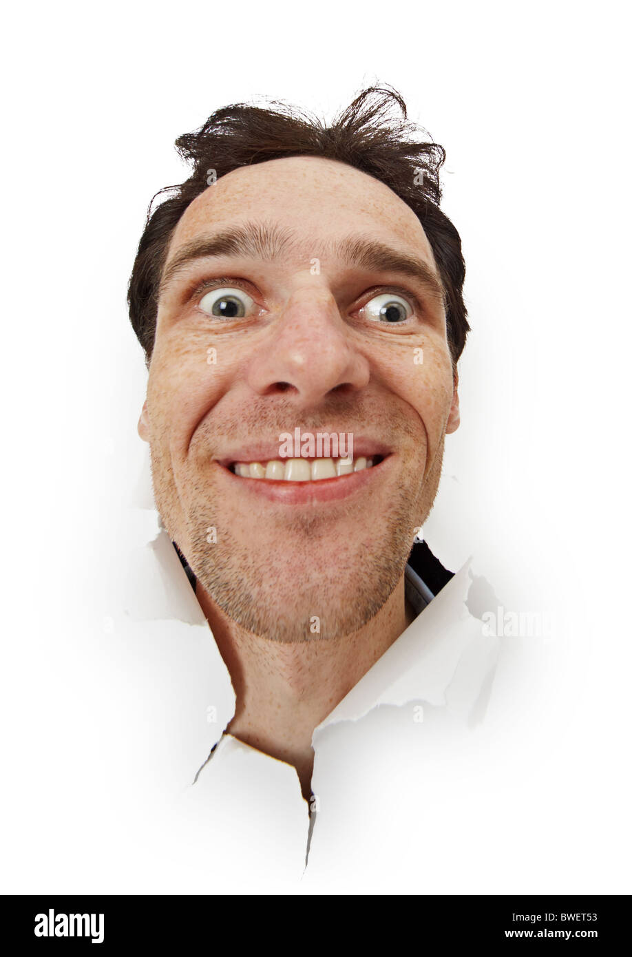 Crazy funny man opened his eyes isolated on a white background - Stock Image