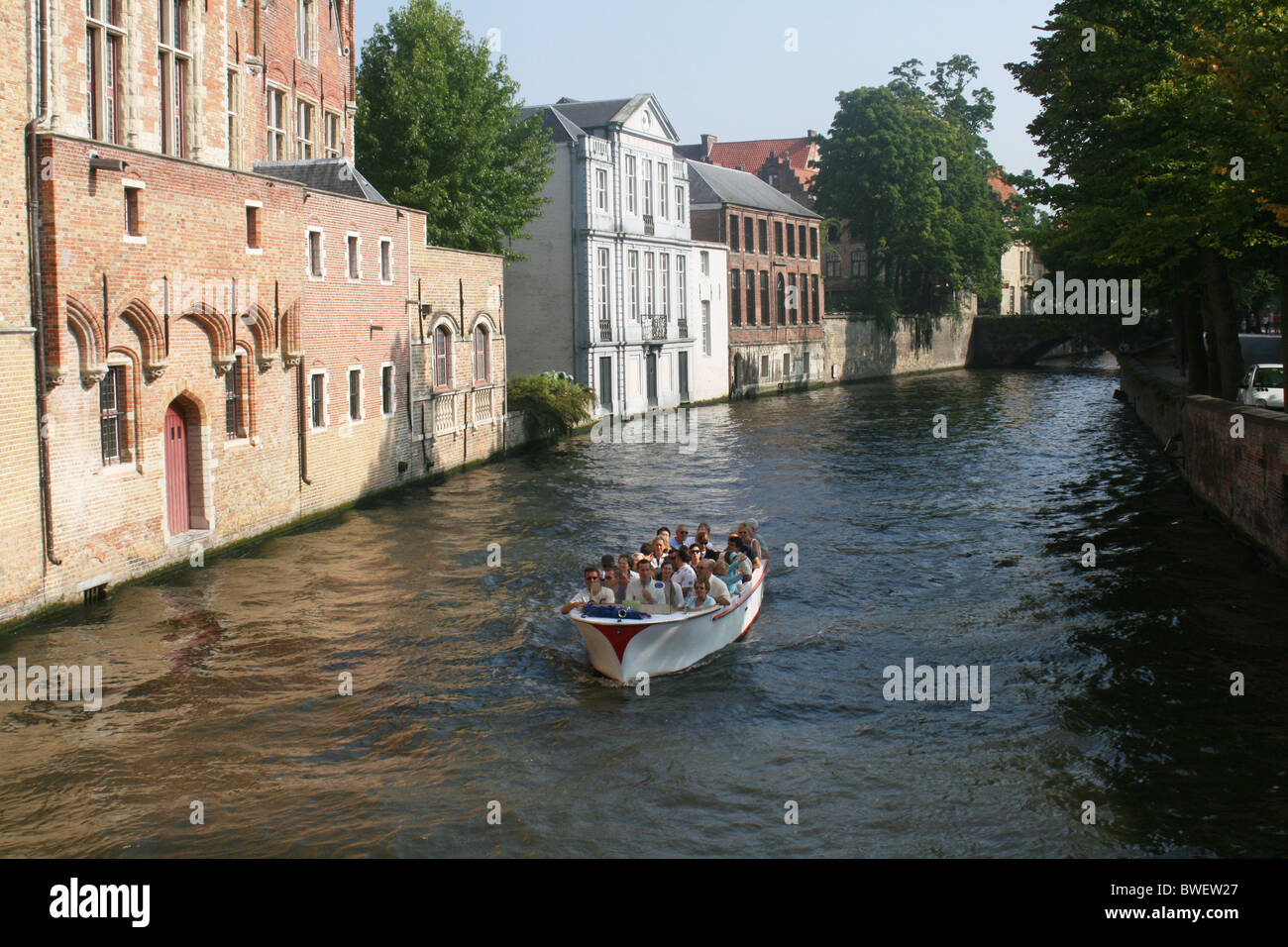 Boat rides on the canal, Bruges, Belgium - Stock Image