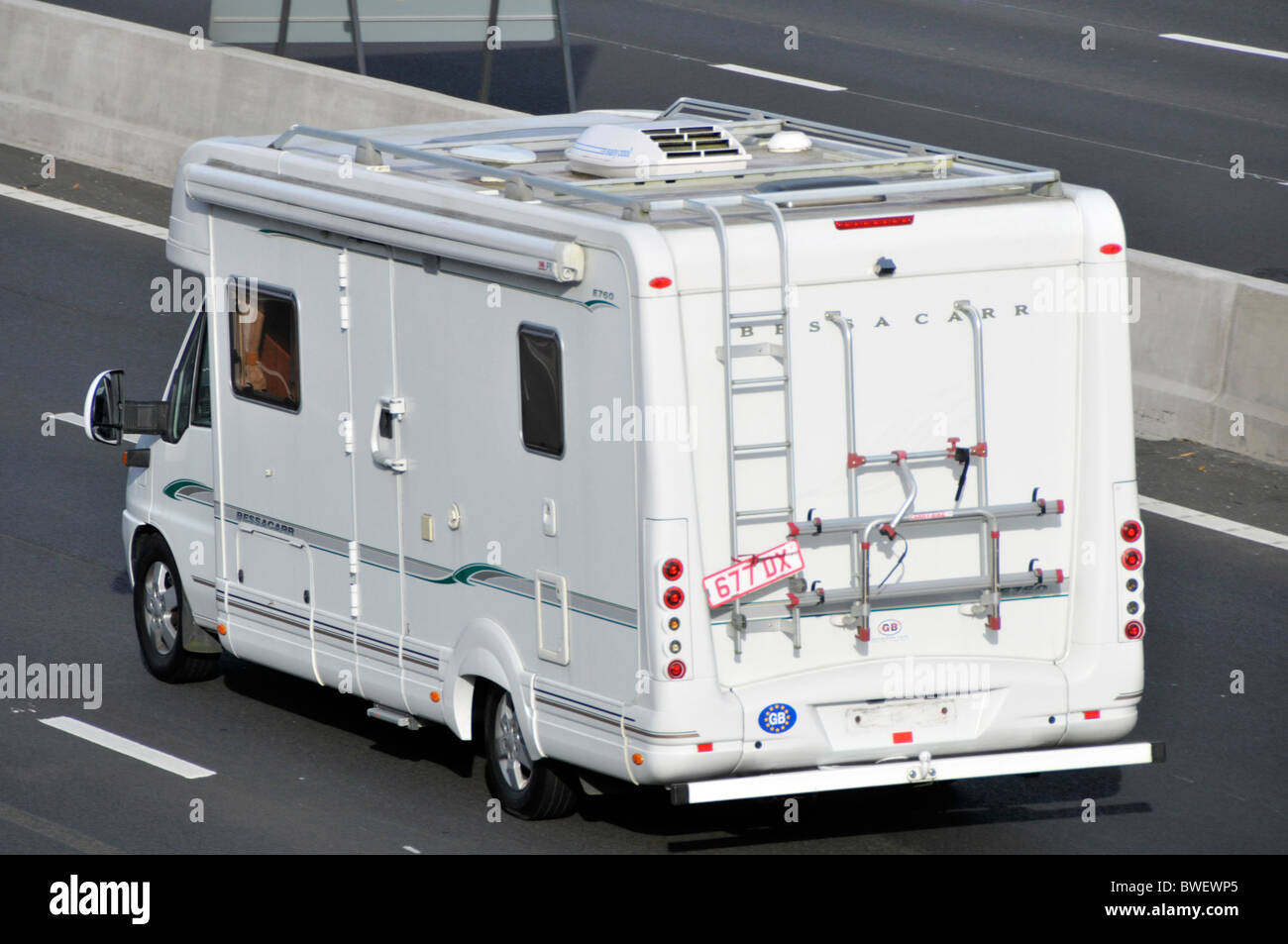 Camper van on M25 motorway driving on trade number plates - Stock Image