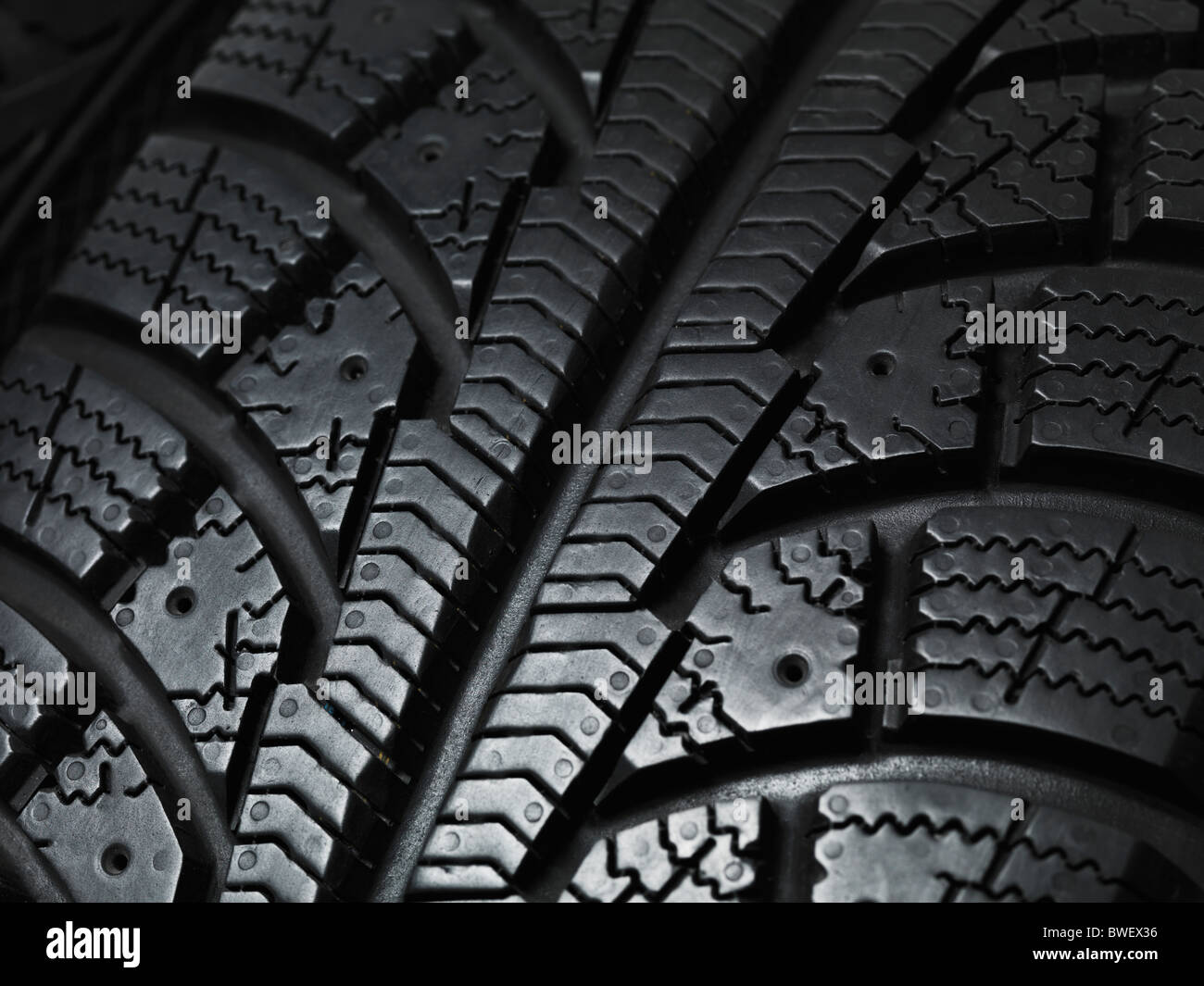 Closeup of a winter car tire tread texture - Stock Image