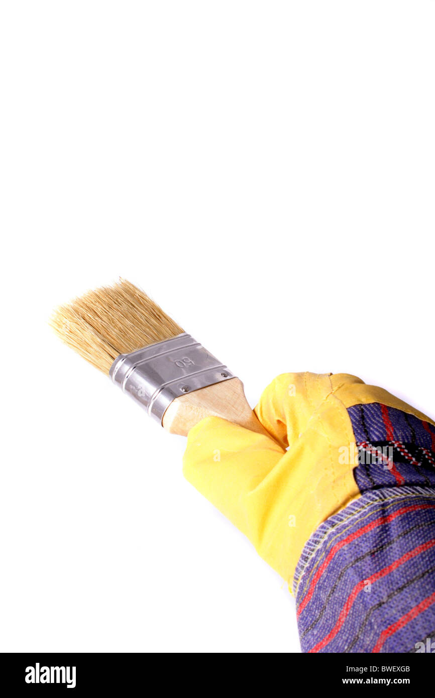 A view of a painters hand wearing glove, holding a painting brush, isolated on a white background. - Stock Image