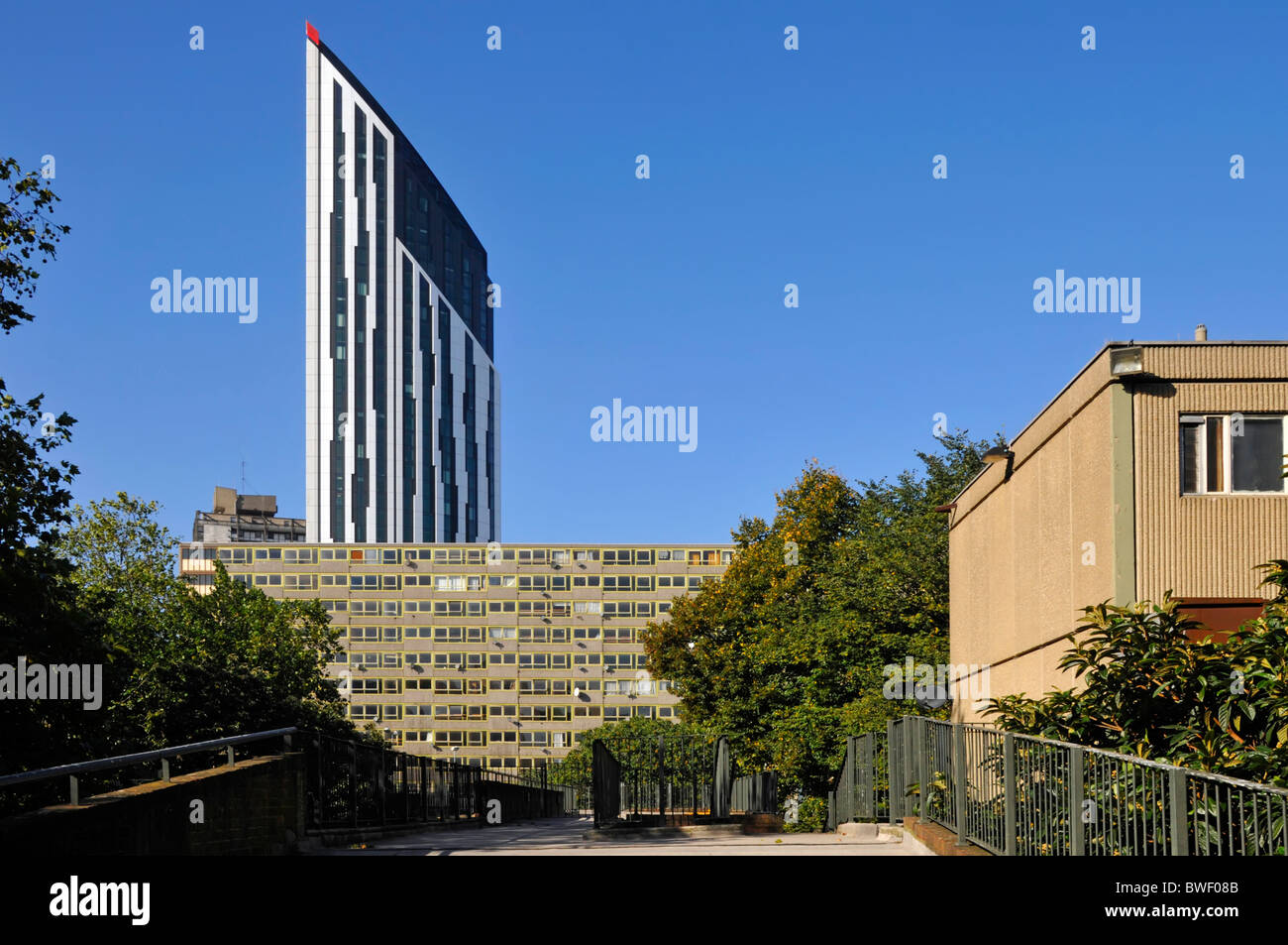 New Strata residential apartment tower block rising above old run-down Heygate council housing Estate at Elephant Stock Photo