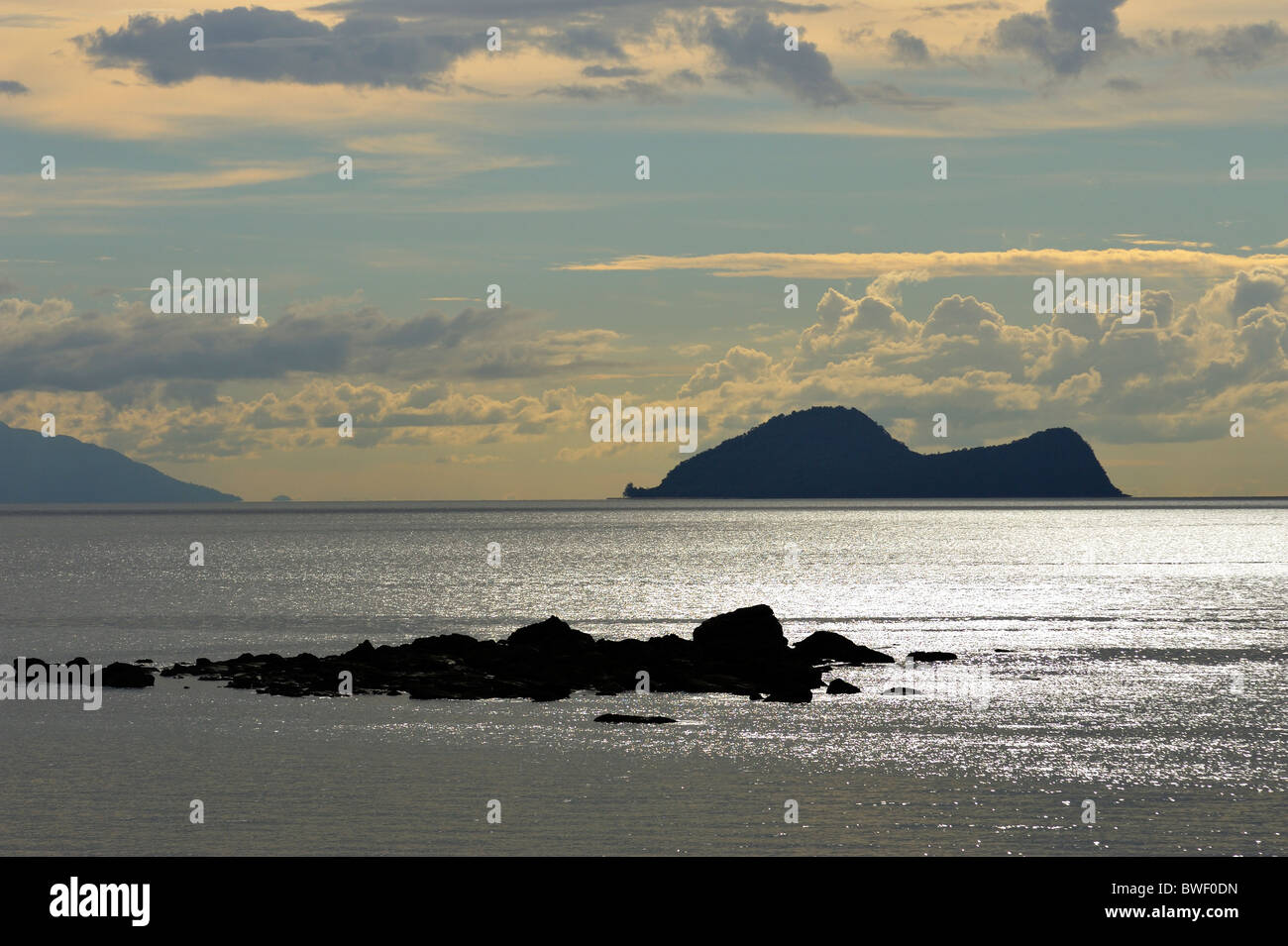 Rocks in the South China Sea with Satang Island behind them - Stock Image