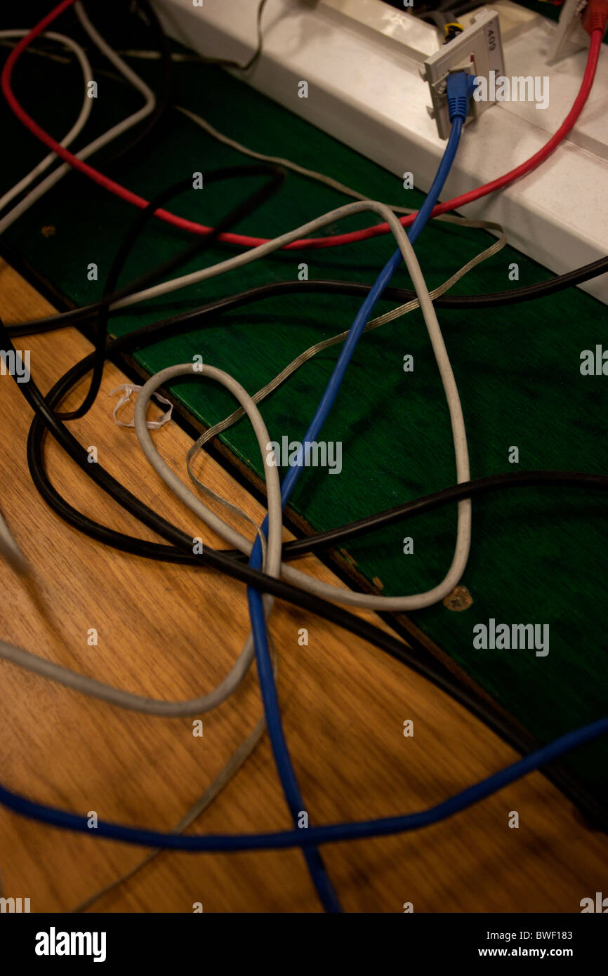 A selection of computer wires on a desk in Brighton, East Sussex, UK. - Stock Image
