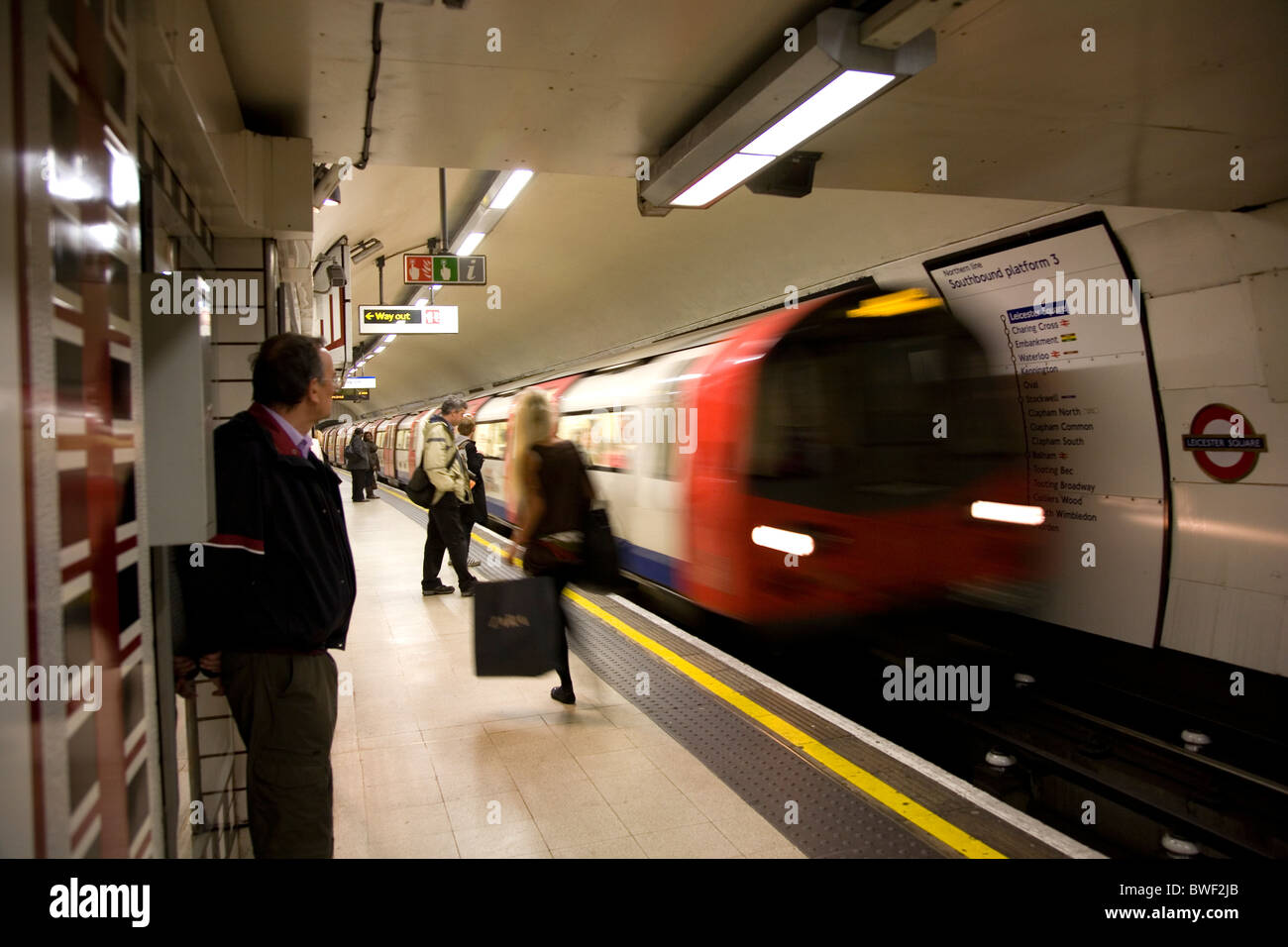 Waiting for Northern Line, Tube on Leicester Square - London UK - Stock Image