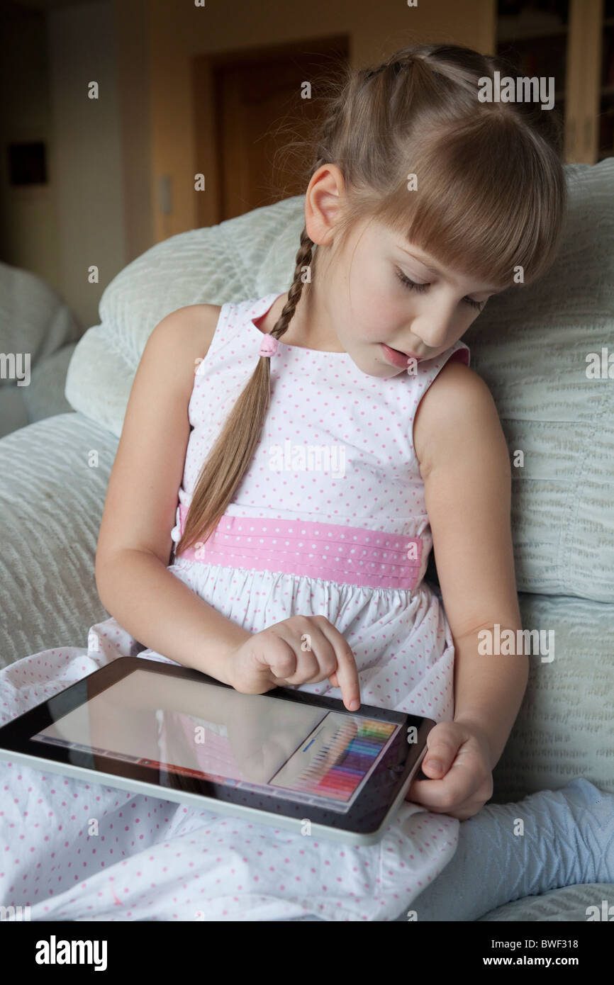 Little girl is using Apple iPad to draw and entertain ...