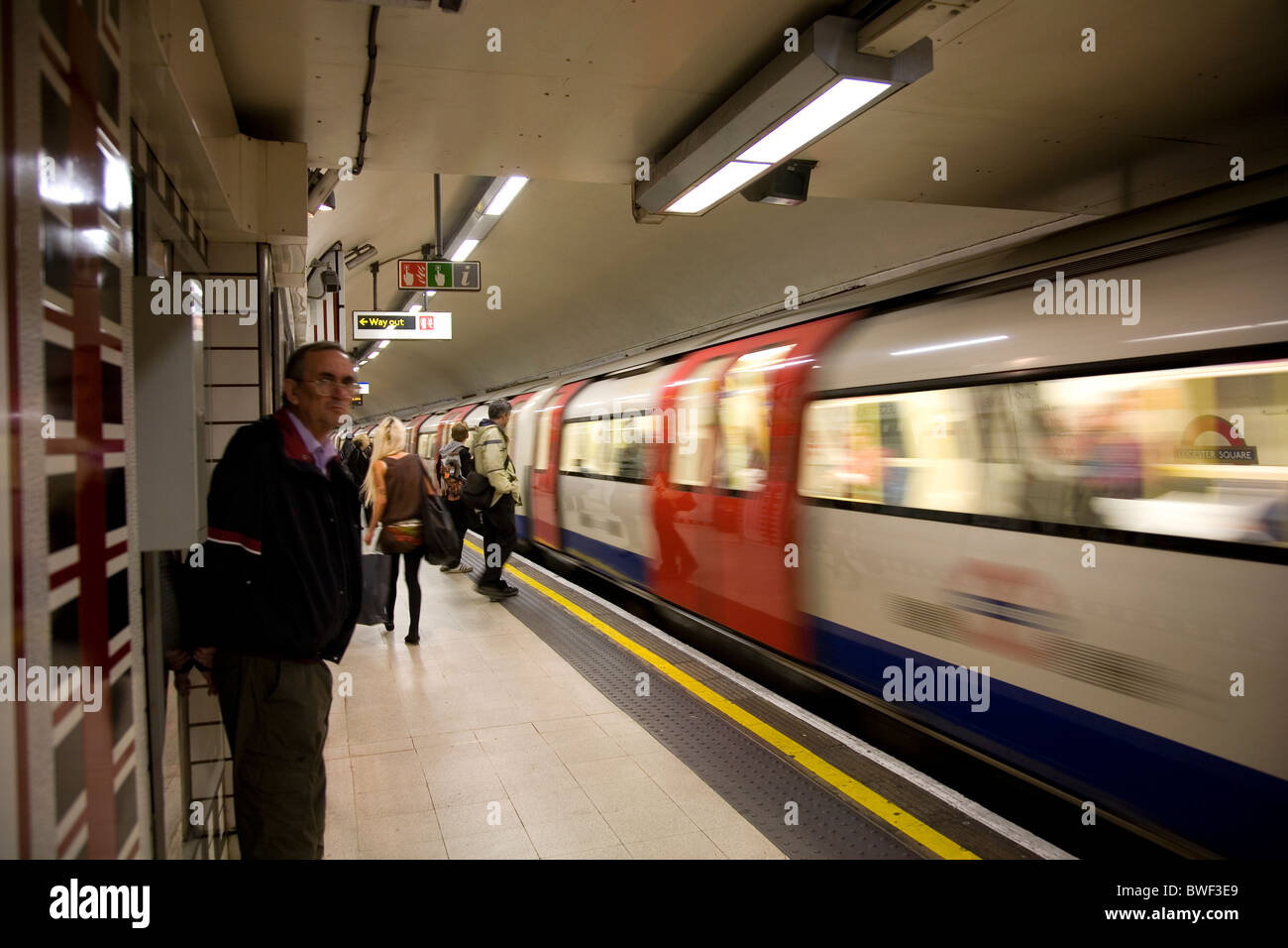 Waiting for Tube on Leicester Square - Stock Image