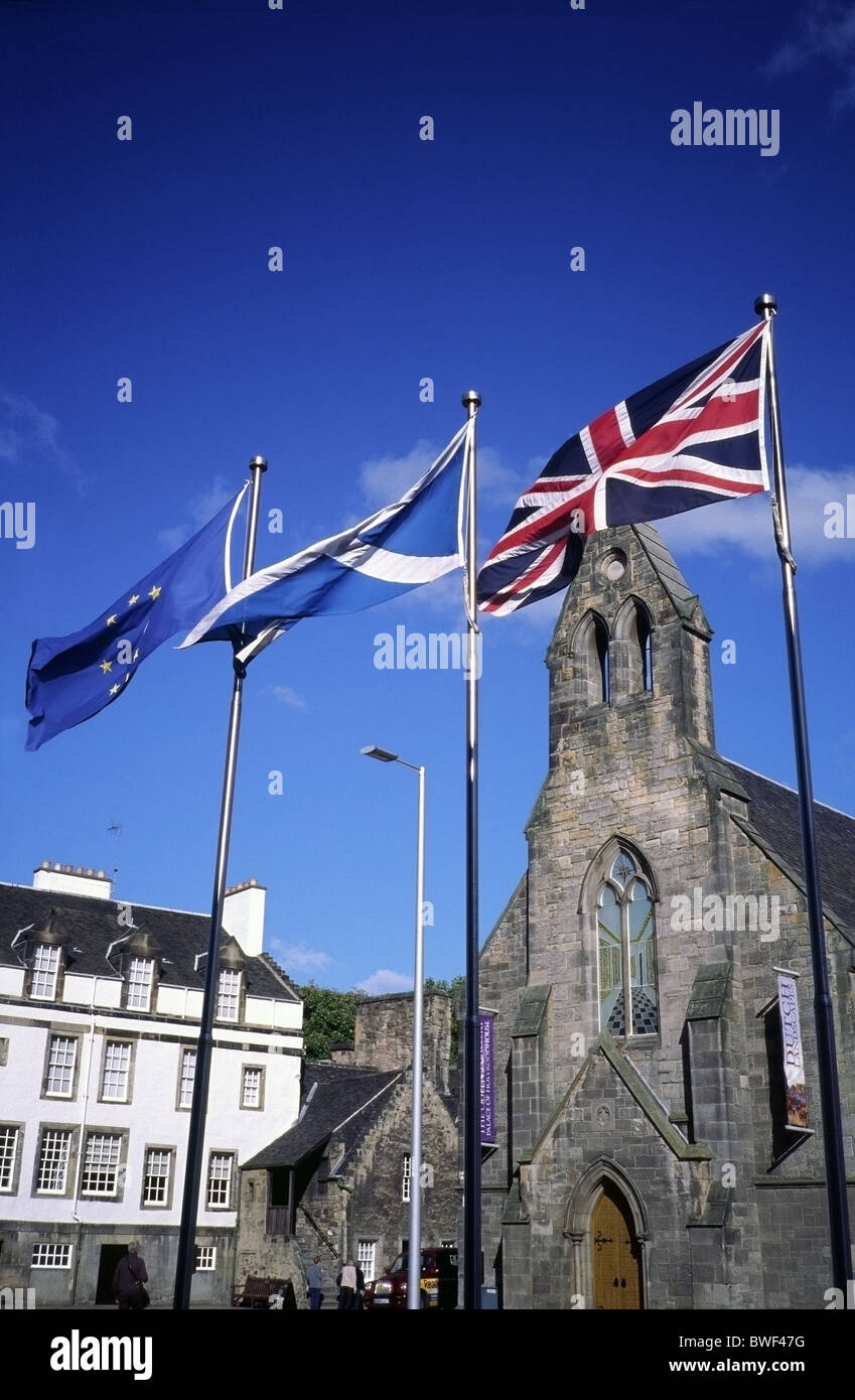 Flags Flying in Holyrood outside the Parliament building looking towards The Queens Gallery, Edinburgh, Scotland - Stock Image