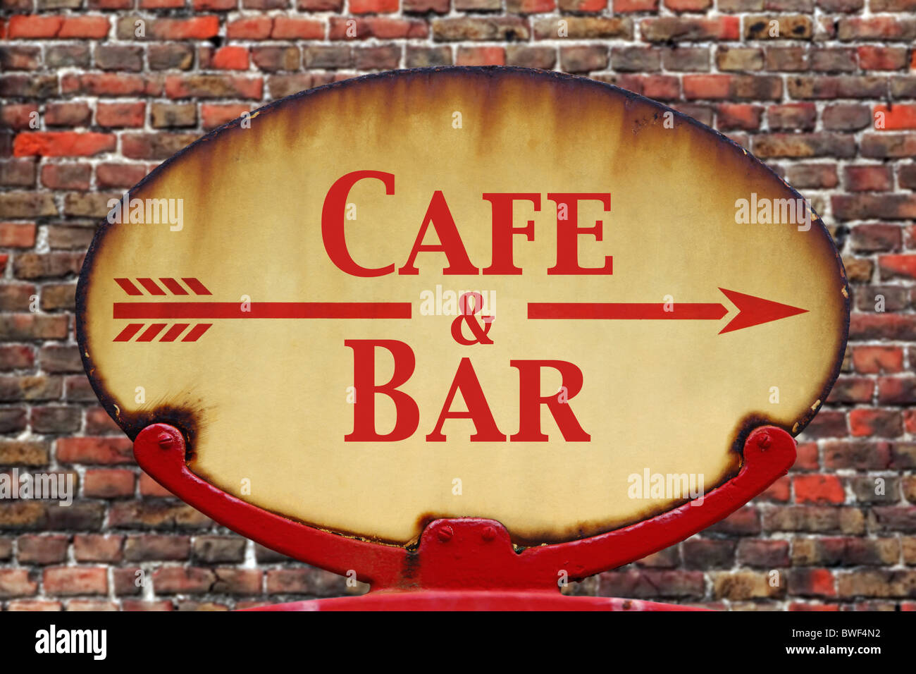 A rusty old retro arrow sign with the text Cafe and Bar - Stock Image