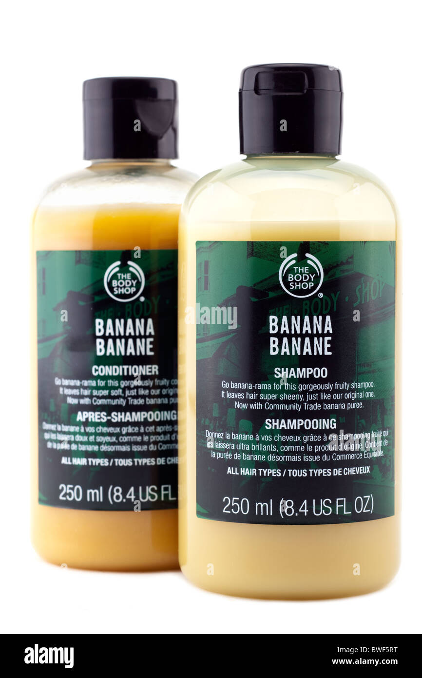 Two 250 ml bottles of The body Shop Banane conditioner and Banana shampoo - Stock Image