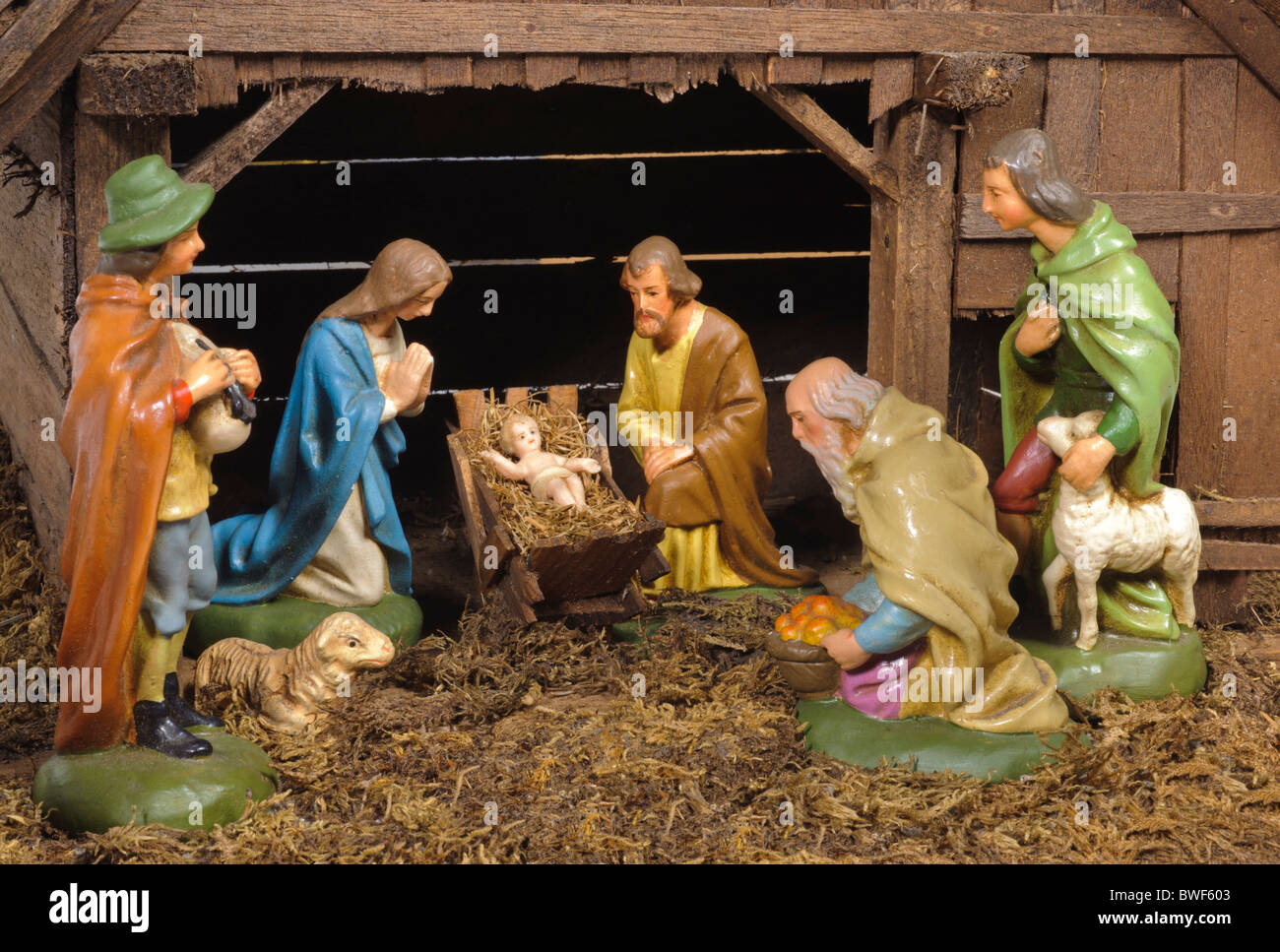 christmas nativity scene of jesus birth in an old cottage nearby bethlehem with mary, joseph and three shepherd Stock Photo