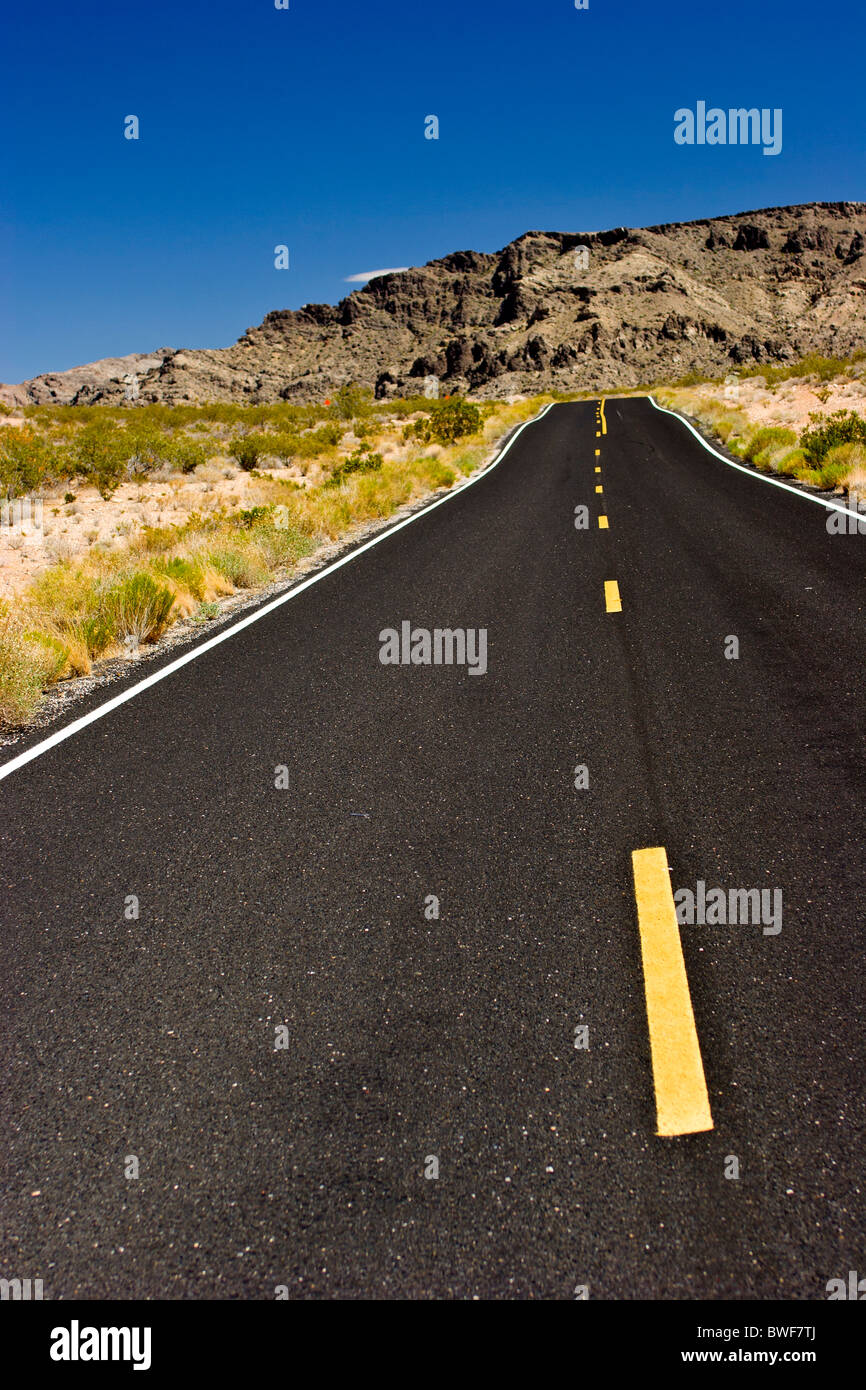 Valley of Fire Hwy. Nevada USA  Empty paved road with yellow line - Stock Image
