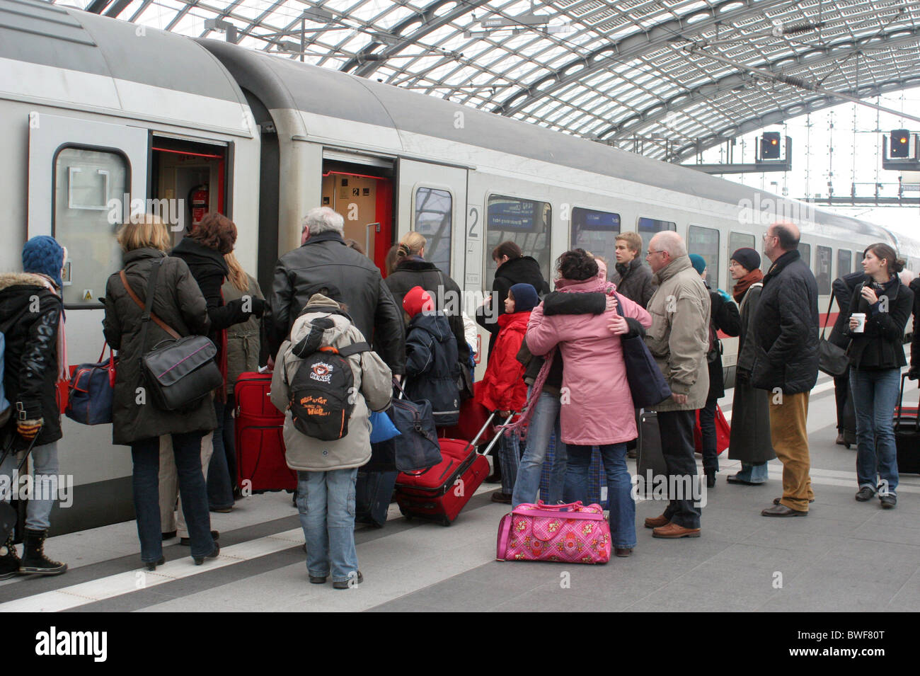 Passengers get on the train at main station, Berlin, Germany - Stock Image