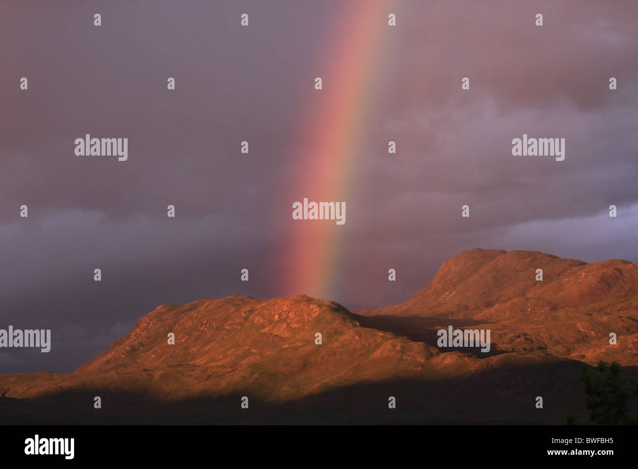 Rainbow Scottish Highlands and mountain - Stock Image