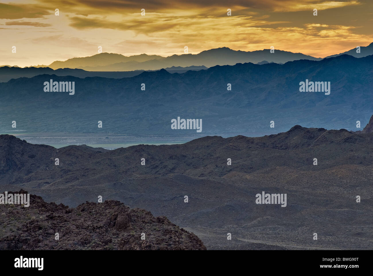 Dead Mountains, California at sunset from Route 66 (Oatman Highway) in Black Mountains, Mojave Desert near Oatman, - Stock Image