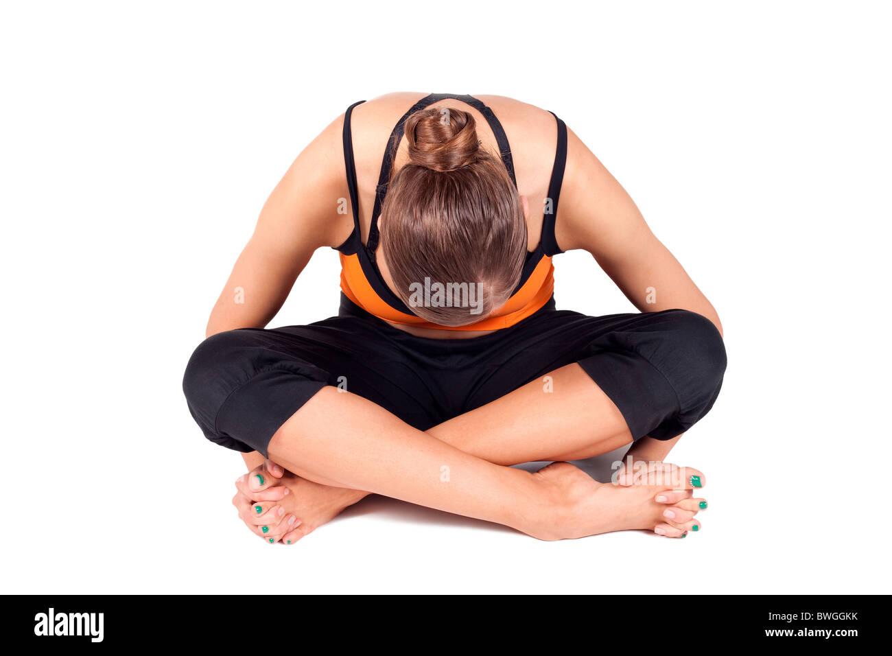 Woman doing toes stretching yoga exercise called Utthita Anguli Sukhasana isolated over white background - Stock Image