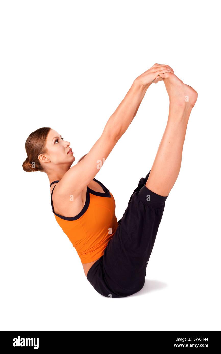 Fit woman doing yoga exercise called Both Big Toes, Sanskrit name: Ubhaya Padangusthasana - Stock Image