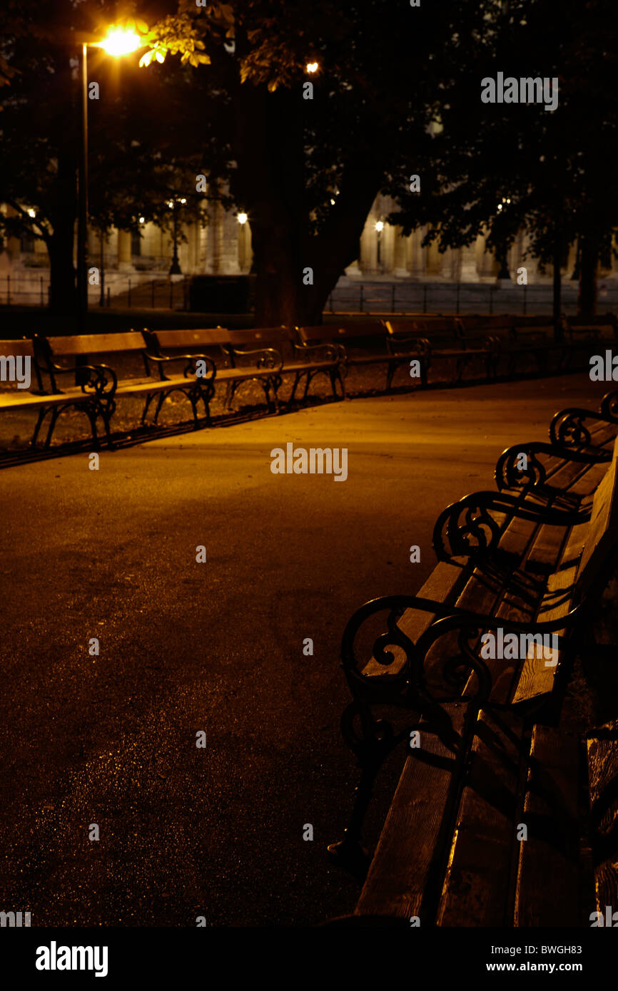 empty park benches at night - Stock Image