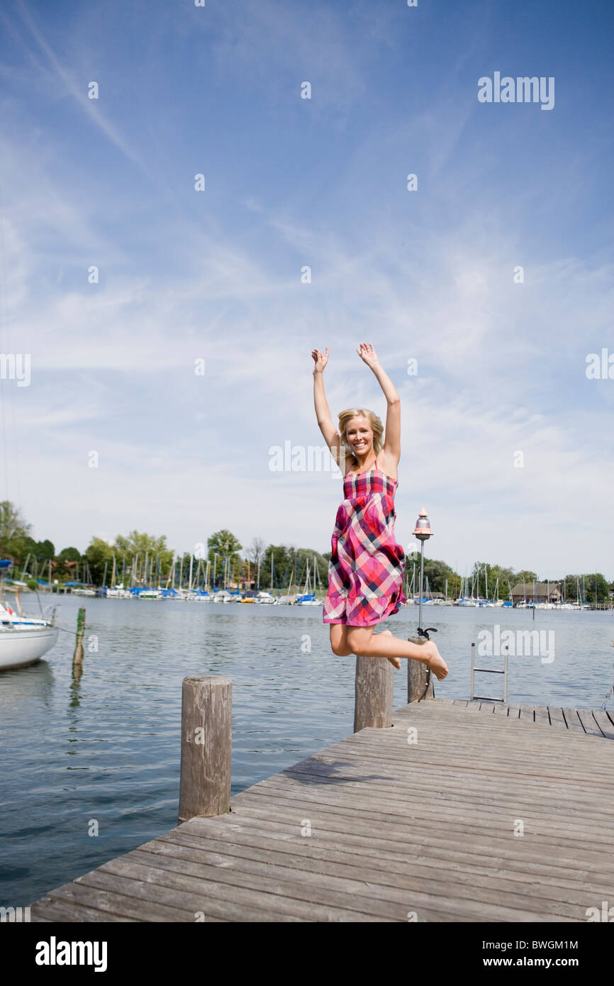 Girl jumping on bar - Stock Image