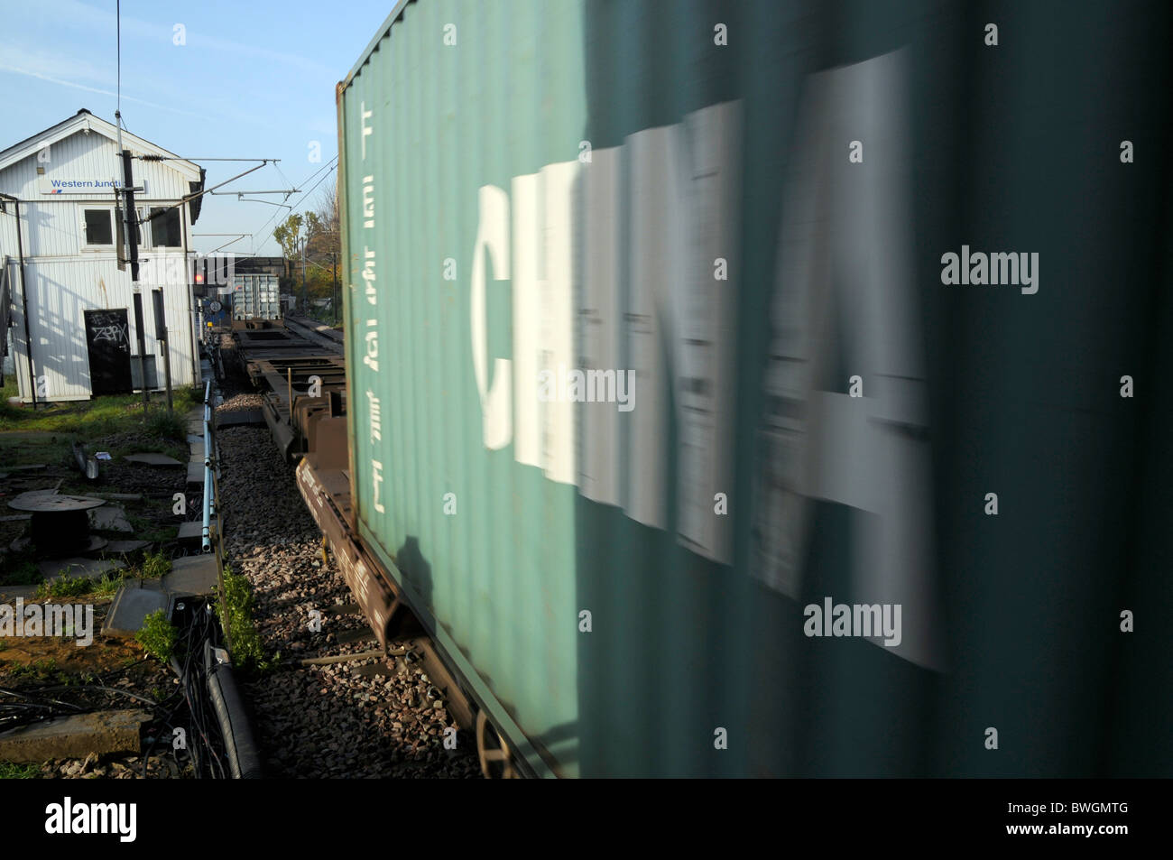 UK. CONTAINER CARRYING GOODS FROM CHINA ON FREIGHT TRAIN IN LONDON OVERGROUND LINE - Stock Image