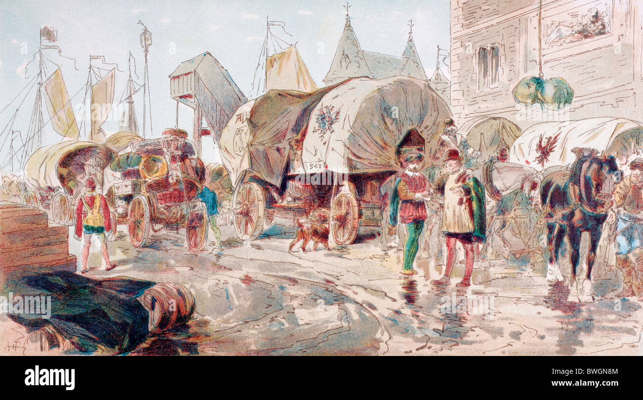 Horse drawn wagons full of goods and belonging to the Hanseatic League arrive at a port. 16th century. - Stock Image