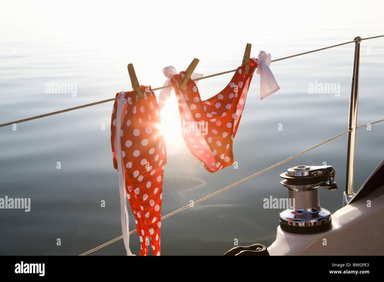 Bikini hanging on rail - Stock Image