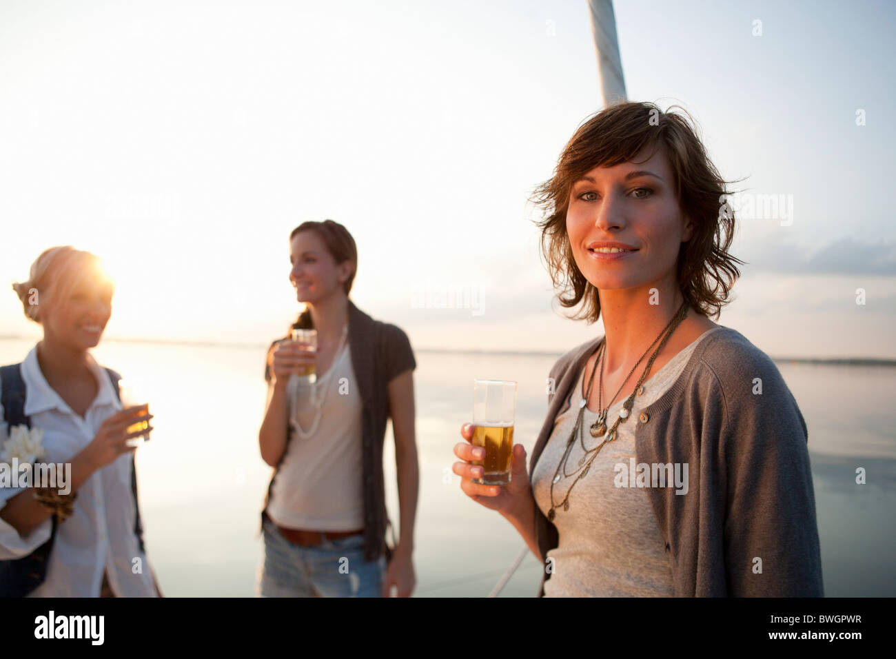Girls drinking beer on boat - Stock Image