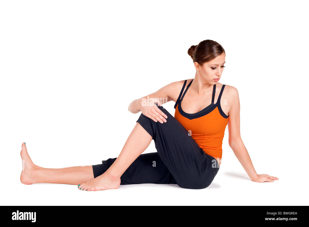 Young Fit Woman Doing First Stage Of Yoga Exercise Called Sage Pose C Sanskrit Name Marichyasana