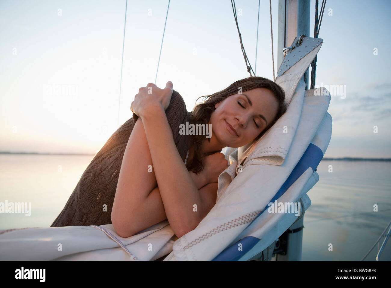 Girl standing on sail - Stock Image