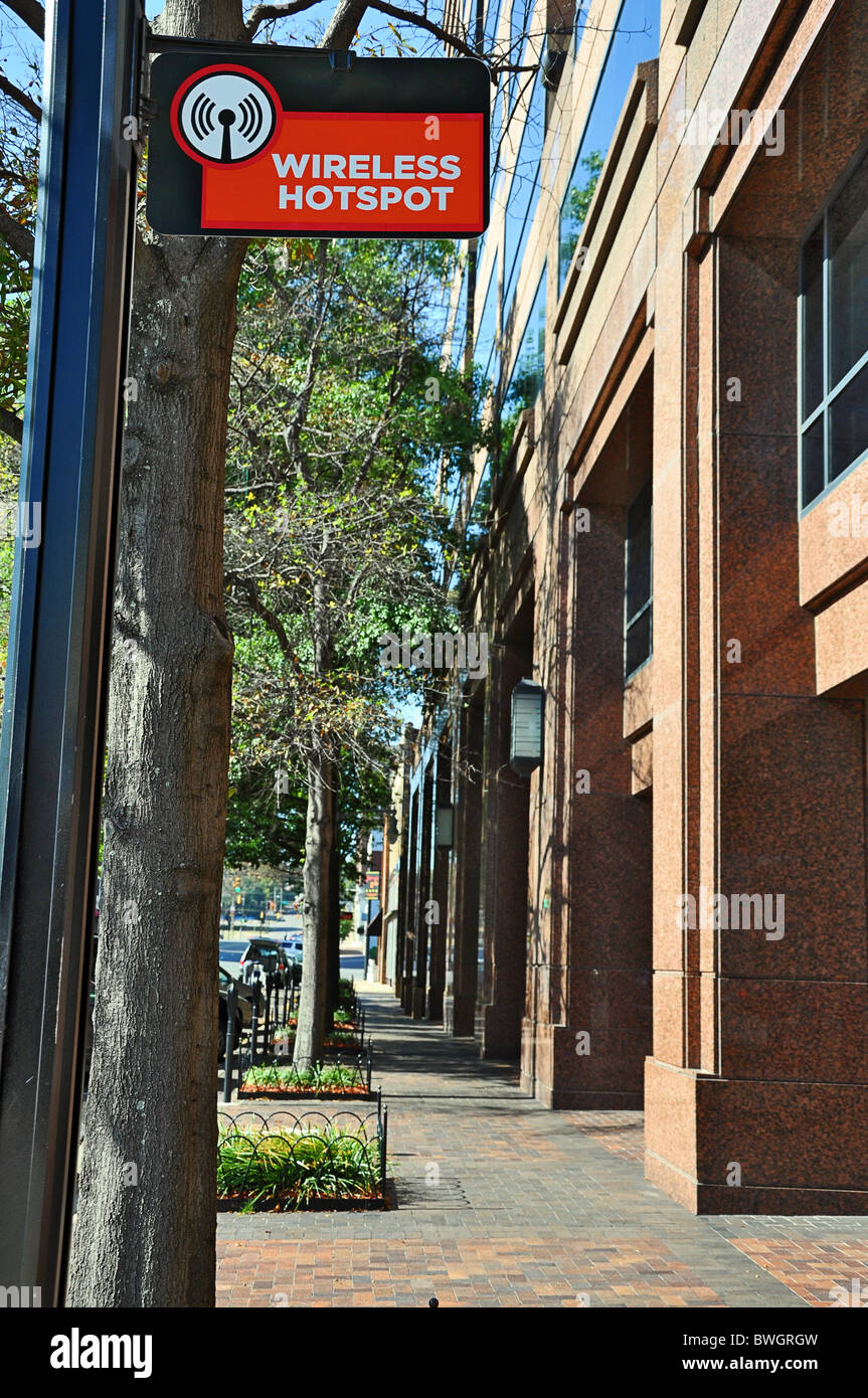 Wireless hot spot sign in downtown area of city. - Stock Image