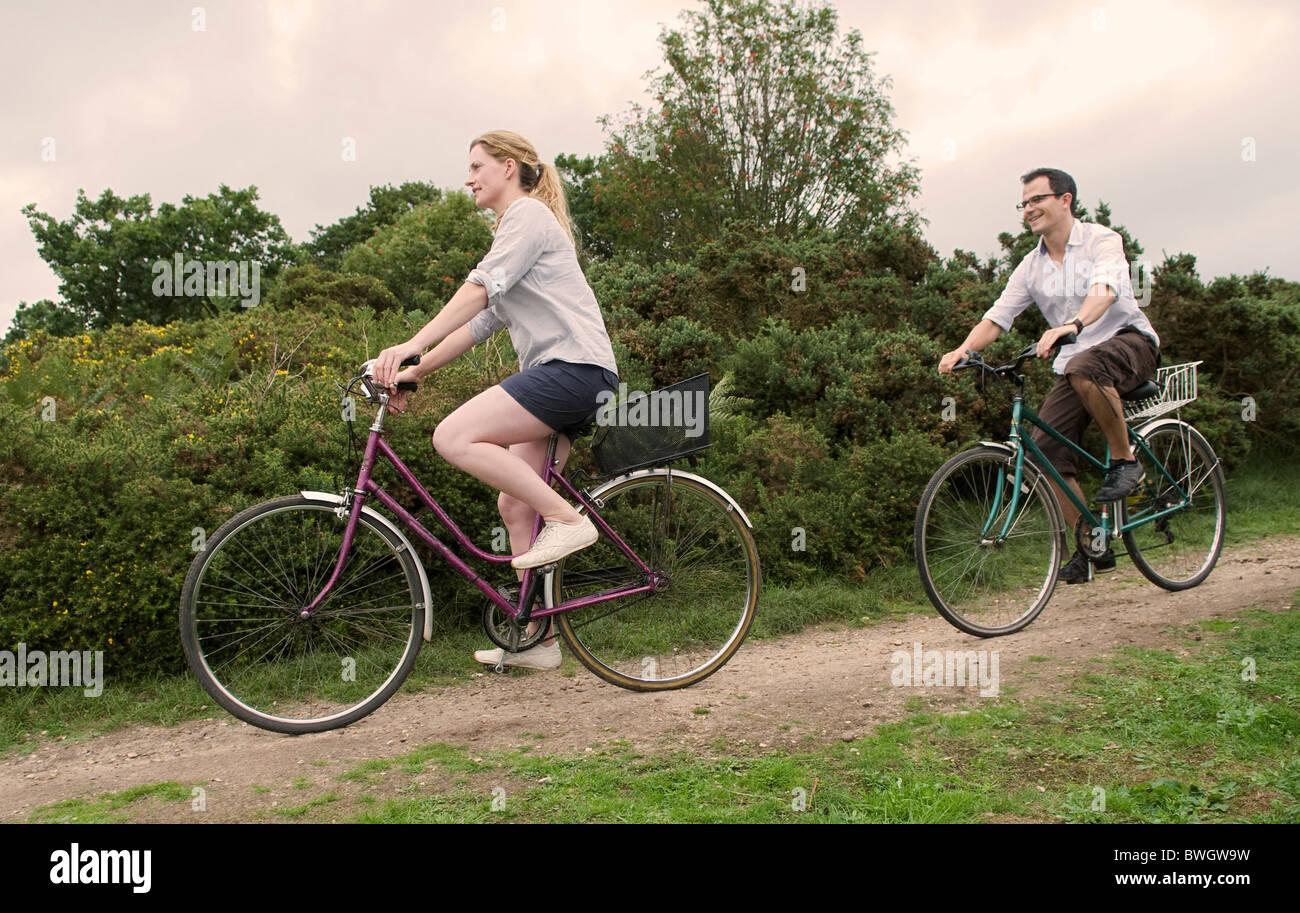 Couple bicycle over heath - Stock Image