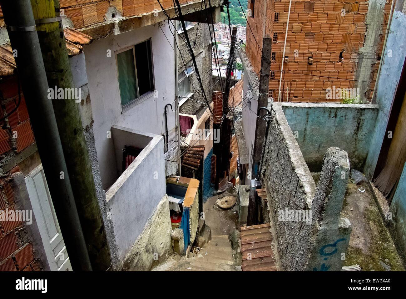 A narrow steep backstreet in Rocinha, the largest slum in Rio de Janeiro. - Stock Image
