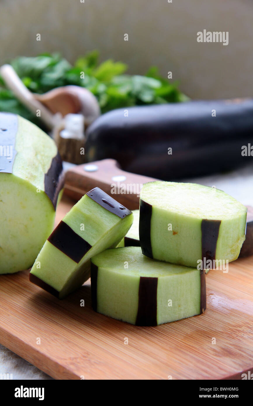 eggplant sliced and purified on a wooden board - Stock Image