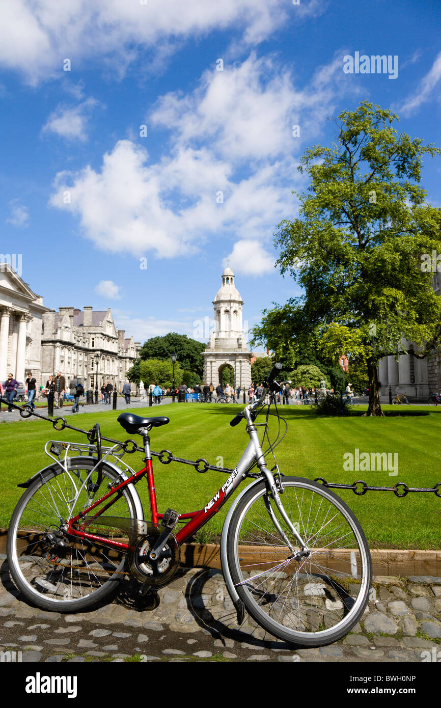 Ireland County Dublin City Trinity College university with people walking through Parliament Square towards Campanile - Stock Image
