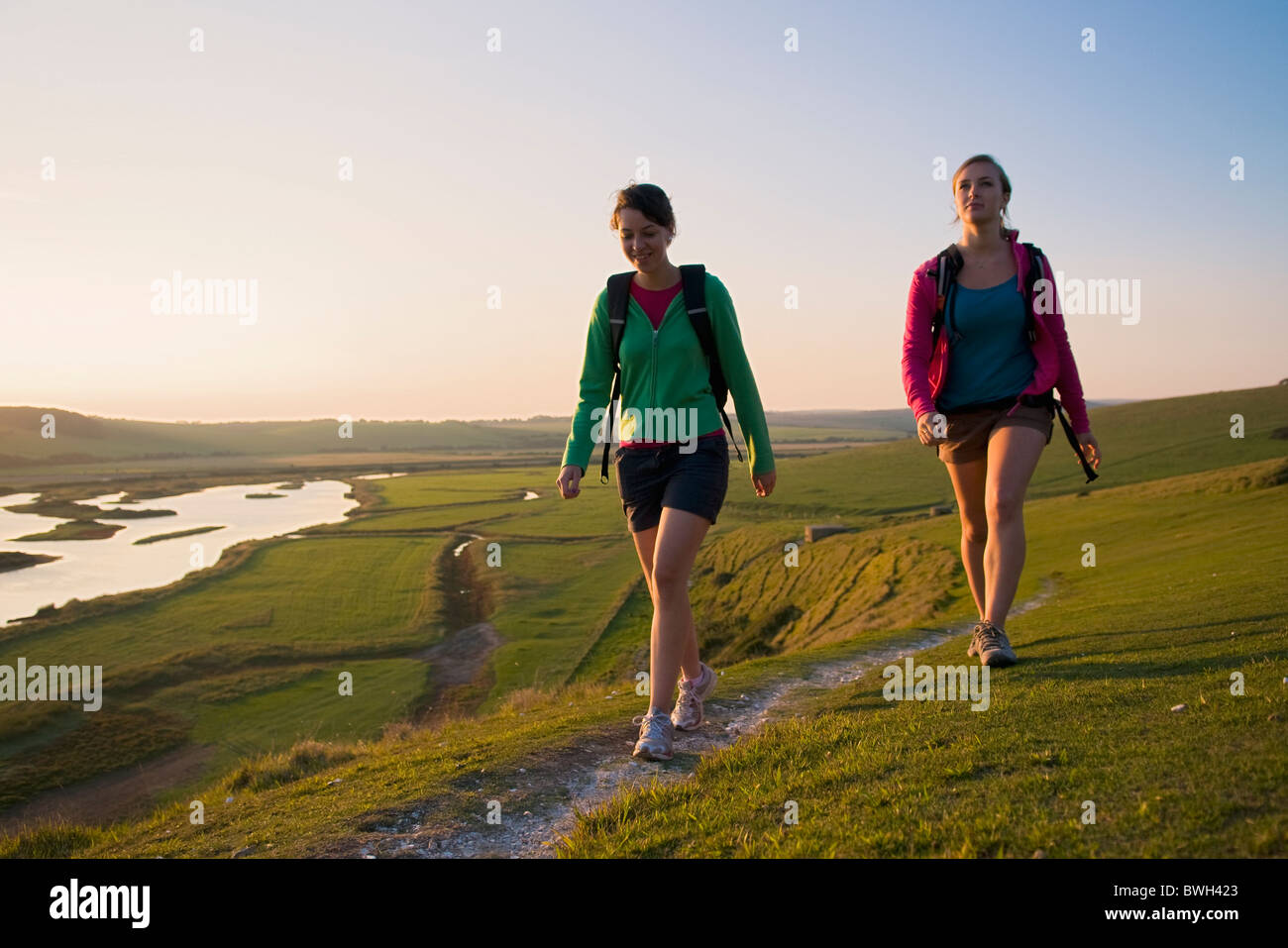 Hikers approach the end of their walk - Stock Image